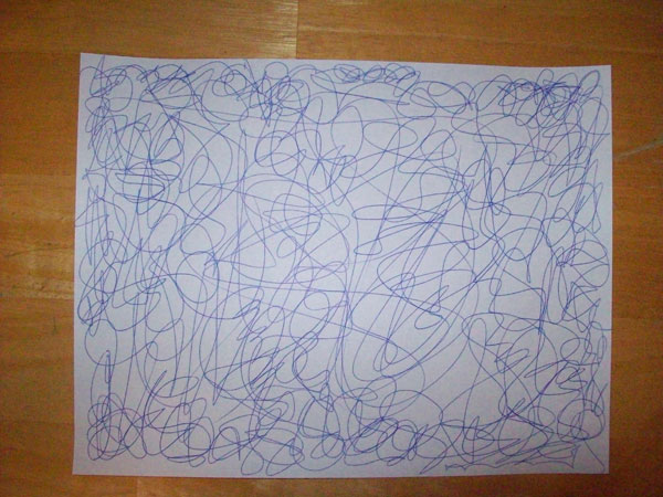 Scribbles on a sheet of paper.